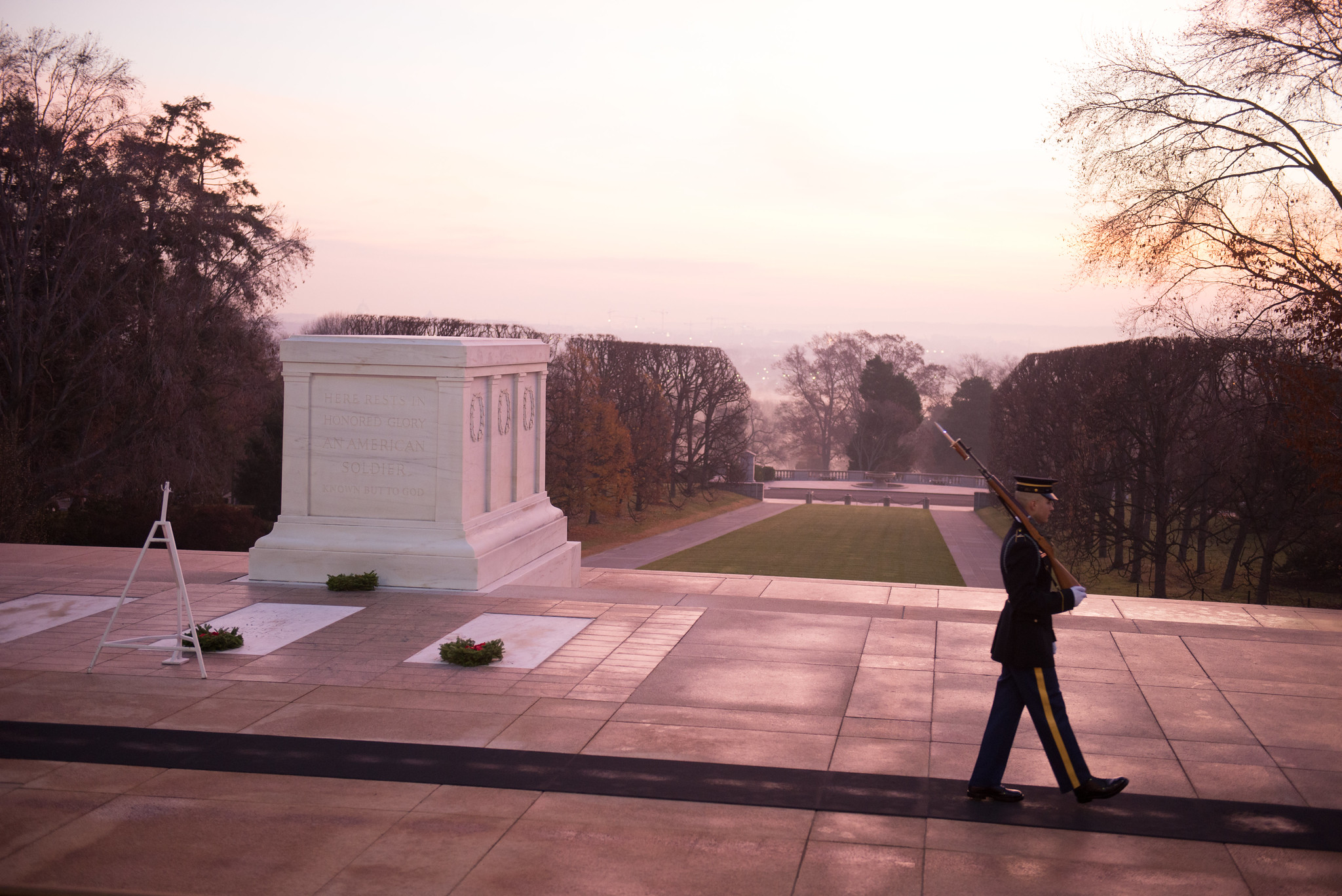 A sentinel of the U.S. Army Old Guard patrols the Tomb of the Unknown Soldier at dawn