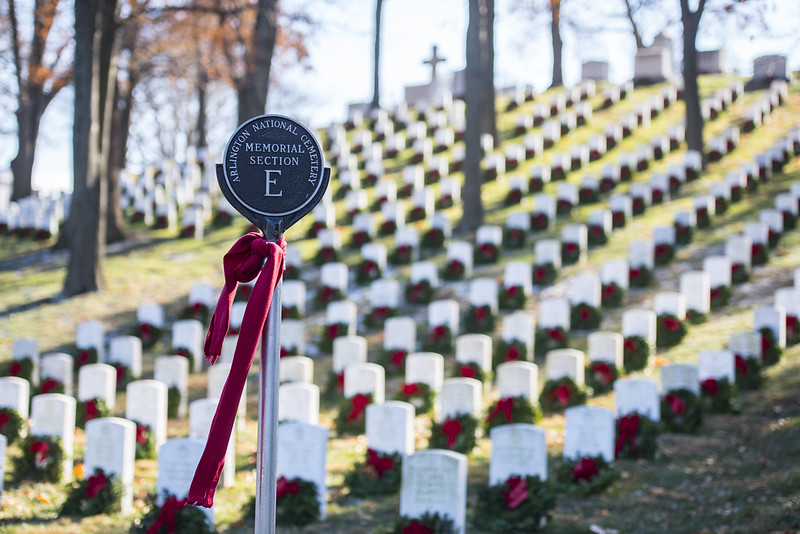 Holiday wreaths on gravestones in Arlington National Cemetery's memorial section