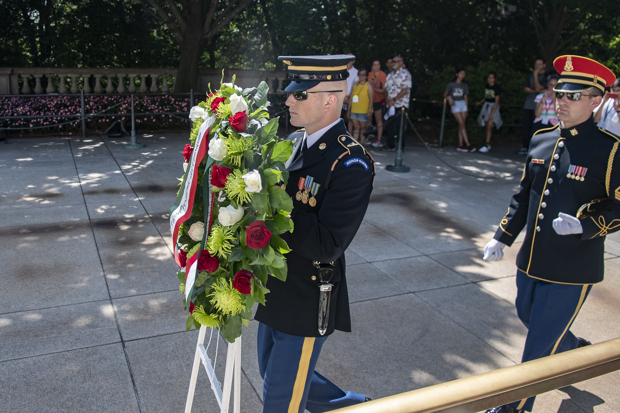 A uniformed soldier plans to lay a wreath at the Tomb of the Unknown Soldier